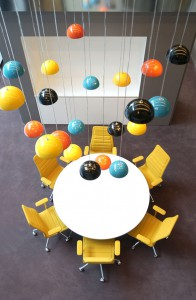 Lamps hanging above round table