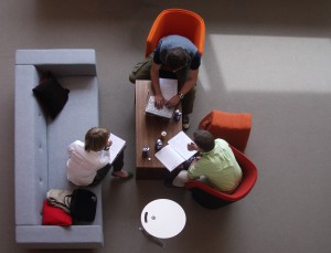 Picture from above, people are working on chairs and bench