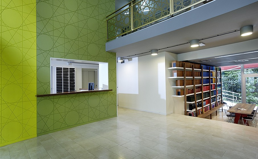 Hall with in the back bookshelves
